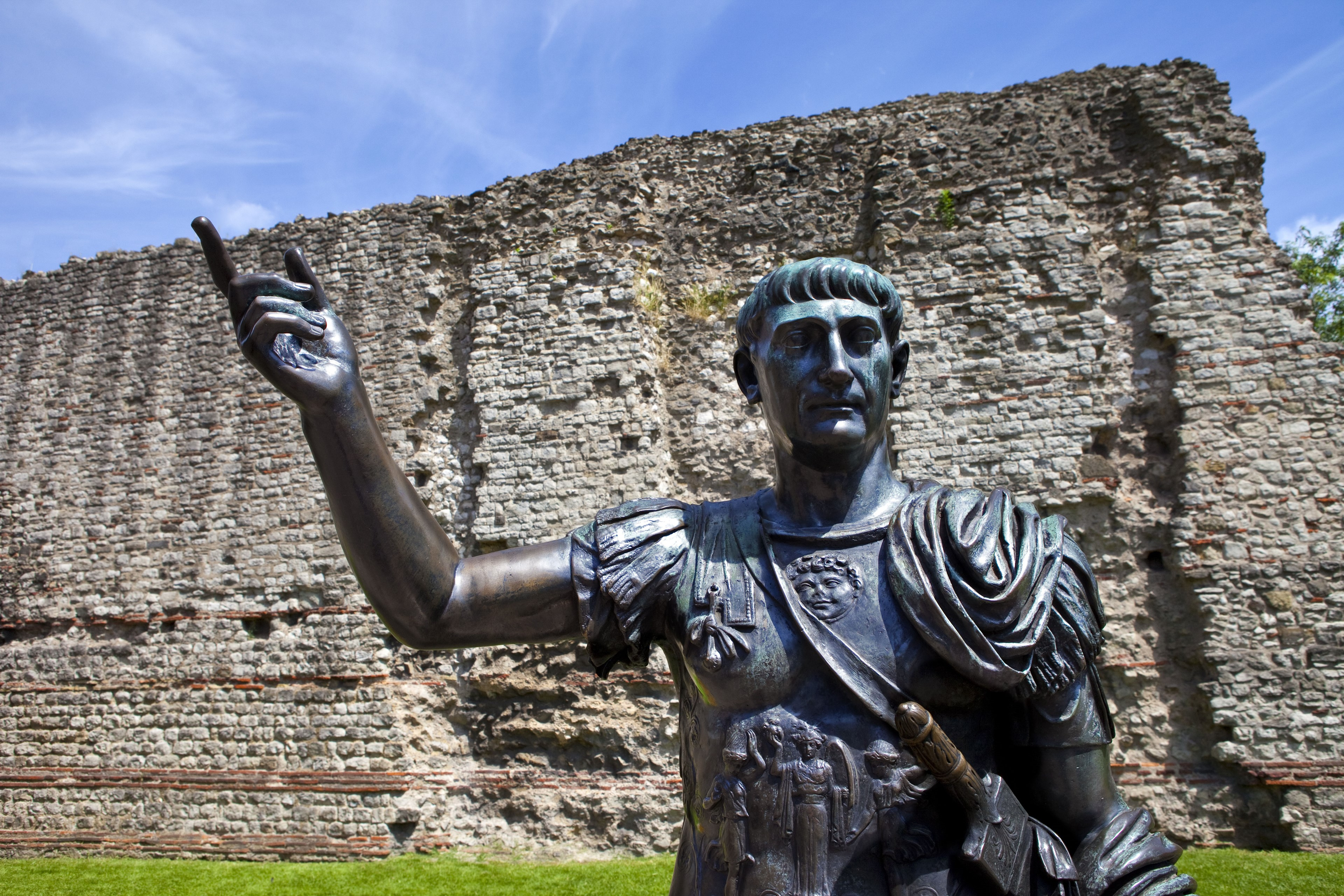 Statue of Roman Emperor Trajan and remains of the London Wall